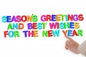 Businesswoman pointing against new year greeting