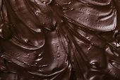 foto of icing  - texture of black chocolate icing close - JPG