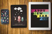Christmas graphics against tablet and smartphone on desk