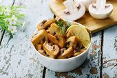 fried mushrooms champignons in a bowl