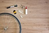 stock photo of levers  - Background with bicycle tools laid out on a wooden floor - JPG