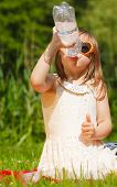 Little Thirsty Girl Child Drink Water From Plastic Bottle, Outdoor