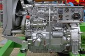 stock photo of outboard engine  - Powerful silver diesel engine for agricultural works - JPG