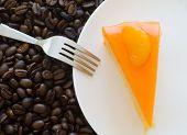 Orange Cake  And Roasted Coffee Beans Background