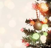 Abstract holiday background with Christmas tree detail and lights
