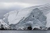 Huge Antarctic iceberg in the snow