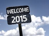 Welcome 2015 sign with clouds and sky background