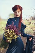 Red-haired Girl With A Bouquet Of Wild Flowers