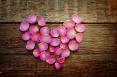 Valentine's Background With Rose Petals In The Shape Of Heart