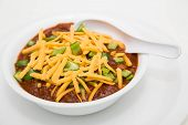 Chilli In White Bowl With Cheese And Poblano Peppers