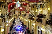 Drawn Snowflakes, Christmas Decorations And Illuminations And Walking People