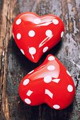 Valentine's day composition with hearts on wooden background