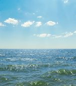 waves on sea and blue sky with clouds