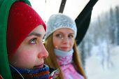 Portrait of happy girls in winterwear at a ski resort