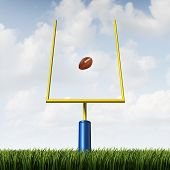 picture of offensive  - American football field goal concept as a team sport kicked ball going between the posts as a metaphor for offense success and winning strategy concept - JPG