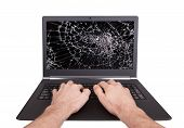 Man Working On A Laptop With A Broken Screen