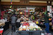 TAKAYAMA, JAPAN - DECEMBER 3, 2014: Locals shopping at the Miyagawa morning market in Takayama, Japan. This morning market sells food items, groceries to farm produce and is common in rural Japan.