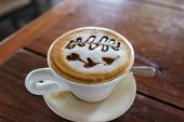 A Cup Of Cappuccino Coffee With Heart-shape Latte Art
