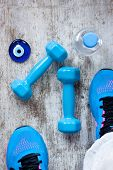 dumbbells and sport shoes