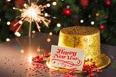 Happy new year card on table set for party with gold hat and champagne