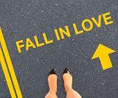 Businesswomans feet against road