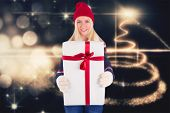 Festive blonde holding a gift against christmas light design