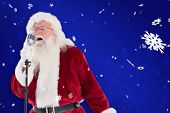 foto of christmas song  - Santa Claus is singing Christmas songs against blue snowflake background - JPG