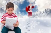 Cute little boy opening gift against blue sky with white clouds