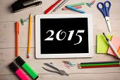 2015 against students desk with tablet pc