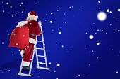 Santa steps up a ladder against blue