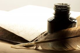 foto of inkpot  - Old book with feather and inkpot in closeup - JPG