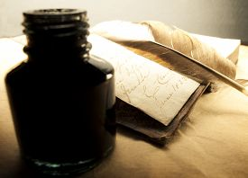 image of inkpot  - Old book with feather and inkpot in closeup - JPG