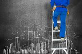 picture of step-ladder  - Low section of carpenter climbing step ladder against hand drawn city plan - JPG