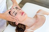 picture of reiki  - Calm woman receiving reiki treatment in the health spa - JPG