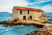 picture of old boat  - Old marina with lonely House and boat in Montenegro - JPG