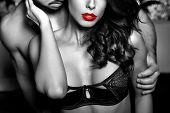 picture of lovers  - Sensual woman in underwear with young lover passionate couple foreplay closeup black and white selective coloring - JPG
