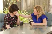 image of comrades  - Women and friendship sharing stories over a cup of coffee outdoors - JPG