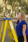 stock photo of comrades  - Women working on household outdoor projects and having fun - JPG