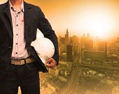 image of land development  - engineering man and sun light behind urban construction background use for land development theme - JPG