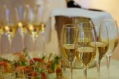 foto of wedding feast  - Close up of festive table with appetizers and drinks - JPG