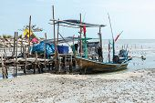 stock photo of tide  - Fishing boat at low tide in the south of Thailand - JPG