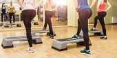 picture of step aerobics  - Group of women making step aerobics view from the backside - JPG