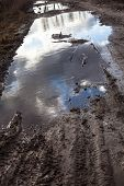 image of boggy  - Mud and puddles on the dirt road - JPG