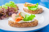pic of sandwich  - sandwiches with salmon and cream cheese on a white table - JPG
