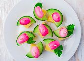 stock photo of radish  - party finger foods with cheese cucumber and radish on a wooden table - JPG