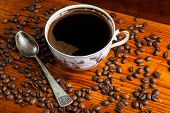 pic of coffee coffee plant  - Coffee beans and cup of coffee on wooden table - JPG