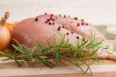 stock photo of breast  - raw chicken breast on wooden cutting board - JPG