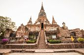 image of gautama buddha  - Old Temple Architecture Wat Yai Chai Mongkol at Ayutthaya Thailand World Heritage Site - JPG