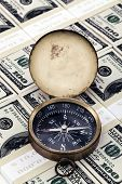 foto of 100 dollars dollar bill american paper money cash stack  - Compass on american dollar bills Close up shot - JPG