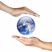 stock photo of planet earth  - two hands saving the earth on white background isolated - JPG